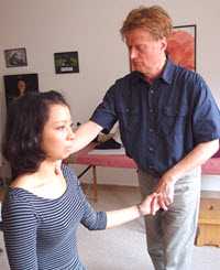 Michael Parkinon works with an Alexander Technique student